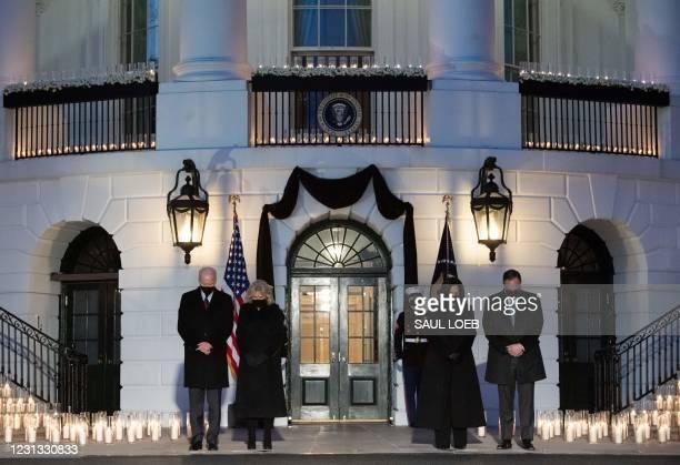 President Joe Biden, First Lady Jill Biden, US Vice President Kamala Harris and her husband, Doug Emhoff, hold a moment of silence during a...