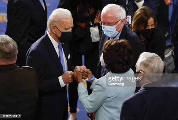 President Joe Biden fist bumps with Representative Maxine Waters, a Democrat from California, following a joint session of Congress at the U.S....