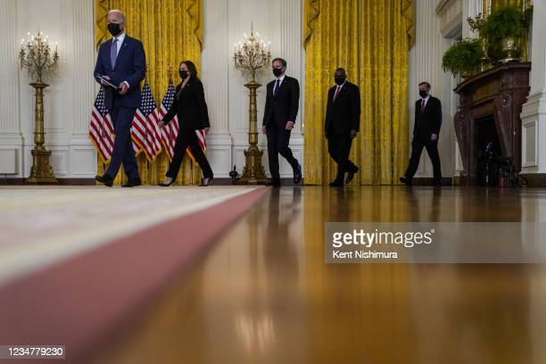 President Joe Biden, followed by Vice President Kamala Harris, Secretary of State Antony Blinken, Secretary of Defense Lloyd Austin and White House...
