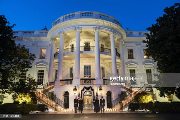 President Joe Biden, from left, First Lady Jill Biden, U.S. Vice President Kamala Harris, and Second Gentleman Douglas Emhoff hold a moment of...