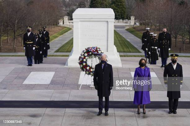 President Joe Biden, from left, Vice President Kamala Harris and Major General Omar J. Jones participate in a wreath laying ceremony at the Tomb of...