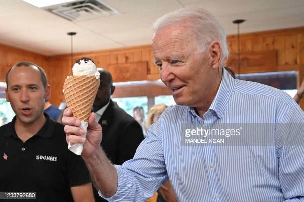 President Joe Biden gets ice cream at Moomers Homemade Ice Cream in Traverse City, Michigan on July 3, 2021.