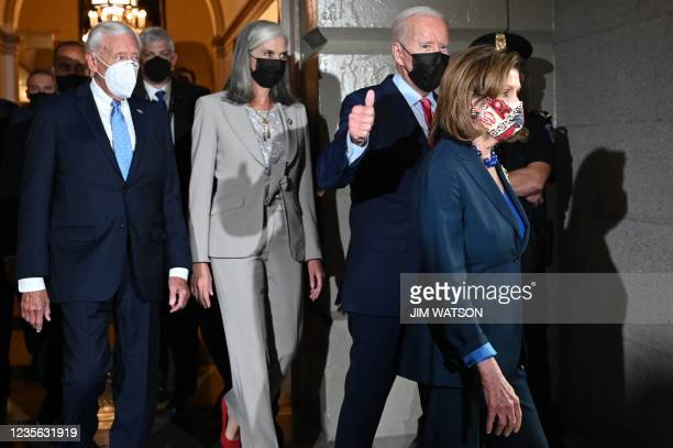 President Joe Biden gives a thumbs up as walks with the Speaker of the US House of Representatives Nancy Pelosi , Majority Leader Steny Hoyer and...