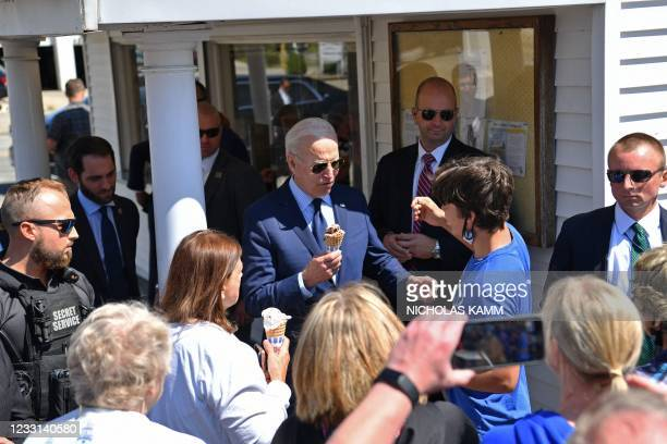 President Joe Biden greets a boy after ordering an ice cream at Honey Hut Ice Cream in Cleveland, Ohio, on May 27, 2021.