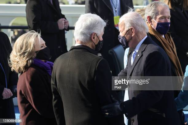 President Joe Biden greets Former U.S. President Bill Clinton and wife Hillary Clinton during Biden's inauguration on the West Front of the U.S....