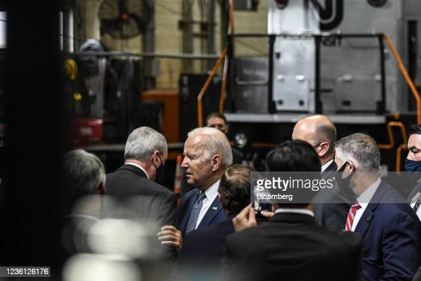 President Joe Biden greets Phil Murphy, New Jersey's governor, left, after speaking at the NJ Transit Meadowlands Maintenance Complex in Kearny, New...