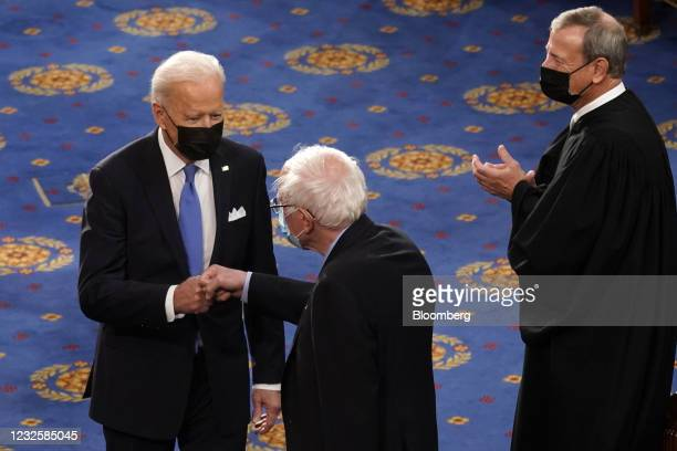 President Joe Biden greets Senator Bernie Sanders, an Independent from Vermont, while arriving to speak during a joint session of Congress at the...