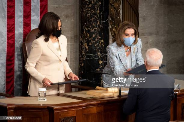 April 28: President Joe Biden hands a copy of his speech to Speaker of the House Nancy Pelosi, D-Calif., after delivering his address to the joint...