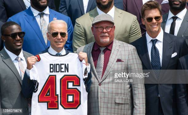 President Joe Biden holds a jersey alongside Tampa Bay Buccaneers head coach Bruce Arians and quarterback Tom Brady during a ceremony honoring the...