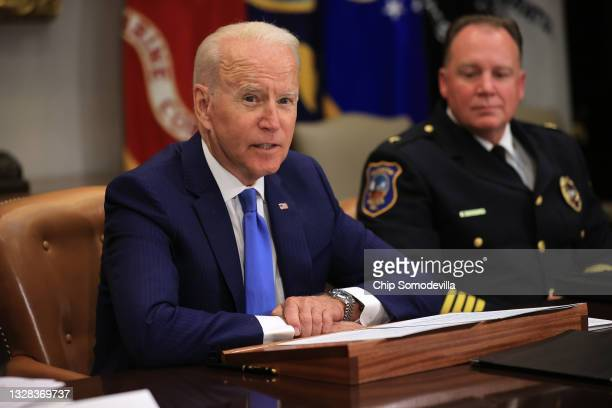 President Joe Biden hosts a meeting with Wilmington, Delaware, Police Chief Robert Tracy about reducing gun violence in the Roosevelt Room at the...