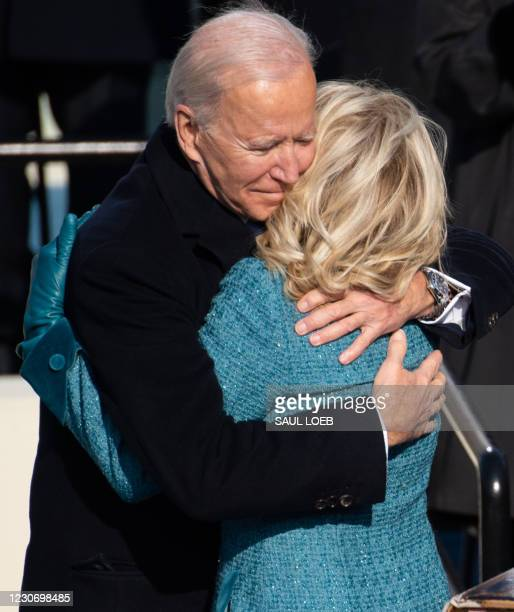 President Joe Biden hugs First Lady Jill Biden after being sworn in as the 46th US President on January 20 at the US Capitol in Washington, DC.