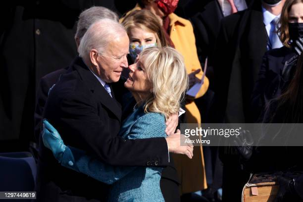 President Joe Biden hugs his wife Dr. Jill Biden after being sworn in during his inauguration on the West Front of the U.S. Capitol on January 20,...