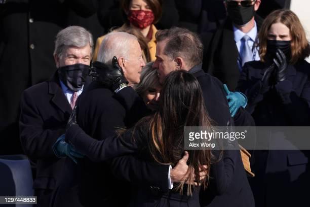 President Joe Biden hugs his wife, Dr. Jill Biden, son Hunter Biden and daughter Ashley Biden after being sworn in as U.S. President during his...