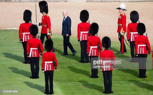 President Joe Biden inspects the Guard of Honour at Windsor Castle on June 13, 2021 in Windsor, England. Queen Elizabeth II hosts US President, Joe...