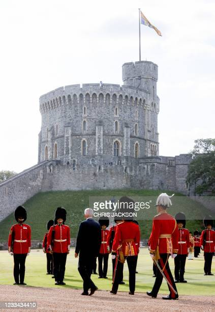 President Joe Biden inspects the Guard of Honour formed of The Queen's Company First Battalion Grenadier Guards at Windsor Castle in Windsor, west of...