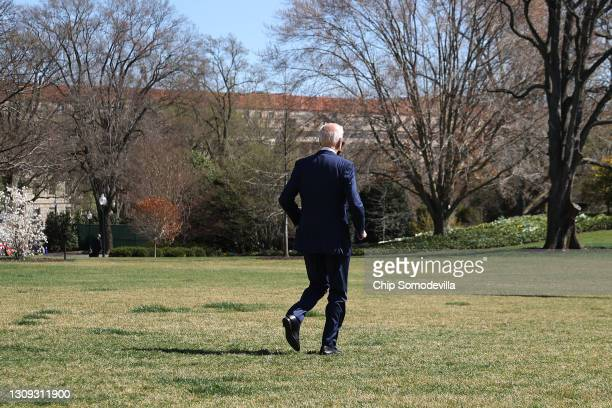 President Joe Biden jogs across the South Lawn before boarding Marine One and departing the White House on March 26, 2021 in Washington, DC. Biden is...