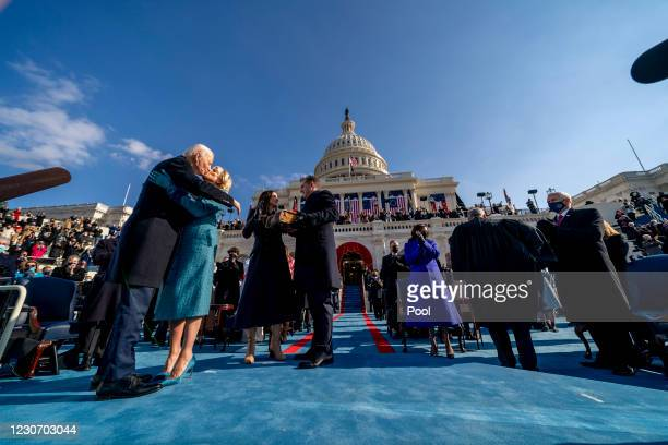 President Joe Biden kisses first lady Jill Biden after being sworn in by Chief Justice John Roberts on the West Front of the U.S. Capitol on January...