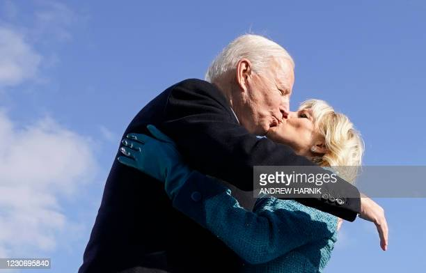President Joe Biden kisses his wife US First Lady Jill Biden after being sworn in during his inauguration as the 46th US President on January 20 at...