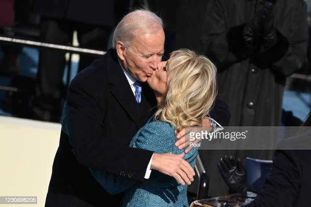 President Joe Biden kisses US First Lady Jill Biden after being sworn in as the 46th US President during the 59th Presidential Inauguration at the...