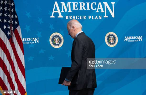 President Joe Biden leaves after speaking about the American Rescue Plan and the Paycheck Protection Program for small businesses in response to...