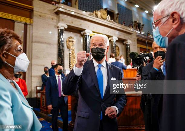 President Joe Biden leaves the House Chamber with Rep. Maxine Waters and Sen. Bernie Sanders after the House chamber of the U.S. Capitol April 28,...