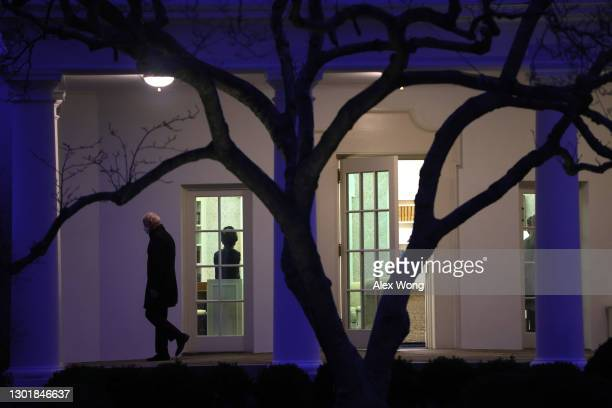 President Joe Biden leaves the Oval Office prior to a Marine One departure from the South Lawn of the White House February 12, 2021 in Washington,...
