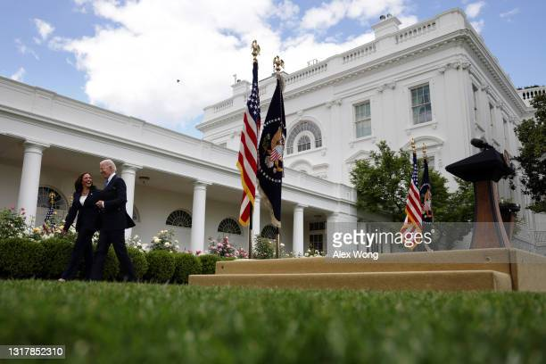 President Joe Biden leaves with Vice President Kamala Harris after he delivered remarks on the COVID-19 response and vaccination program in the Rose...