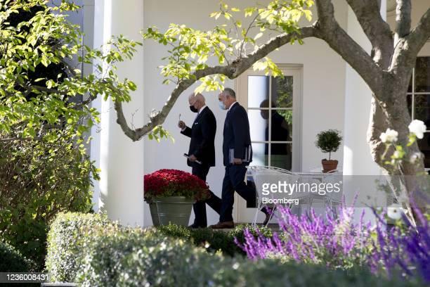 President Joe Biden, left, and Senator Bob Casey, a Democrat from Pennsylvania, depart the White House before boarding Marine One in Washington,...