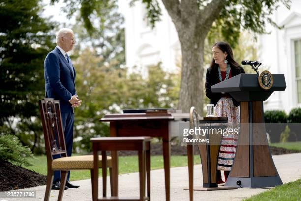 President Joe Biden, left, listens as Deb Haaland, U.S. Secretary of the interior, speaks on the North Lawn of the White House in Washington, D.C.,...