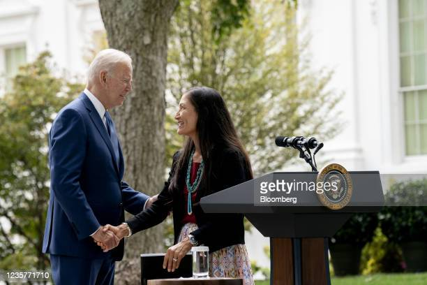 President Joe Biden, left, shakes hands with Deb Haaland, U.S. Secretary of the interior, on the North Lawn of the White House in Washington, D.C.,...