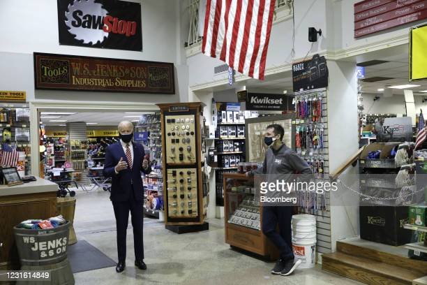 President Joe Biden, left, speaks during a visit at W.S. Jenks & Son hardware store in Washington, D.C., U.S., on Tuesday, March 9, 2021. The new...