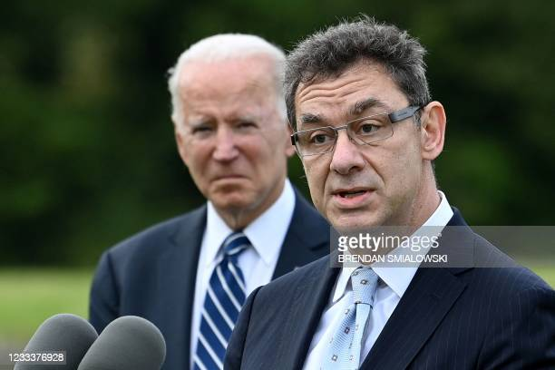 President Joe Biden listens as Pfizer CEO Albert Bourla makes a statements in St Ives, Cornwall on June 10 ahead of the three-day G7 summit being...