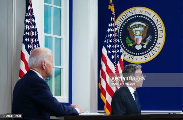 President Joe Biden listens as Secretary of State Antony Blinken addresses a virtual meeting with the Major Economies Forum on Energy and Climate to...