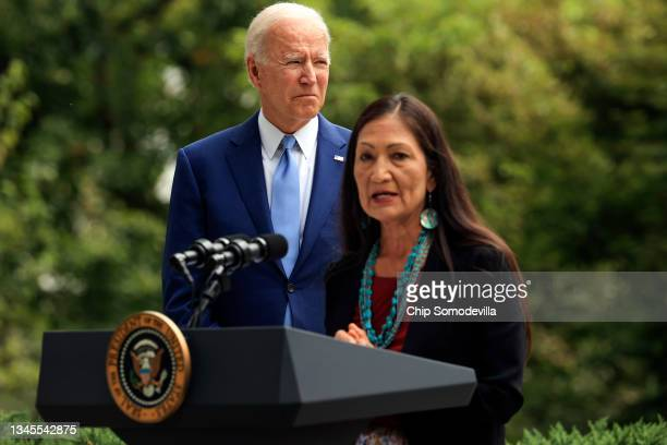 President Joe Biden listens as Secretary of the Interior Deb Haaland delivers remarks before Biden announced the expansion of areas of three national...