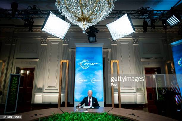 President Joe Biden listens during a virtual Leaders Summit on Climate with 40 world leaders at the East Room of the White House April 22, 2021 in...