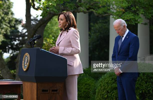 President Joe Biden listens to US Vice President Kamala Harris in the Rose Garden of the White House in Washington, DC, August 5 before he signs a...