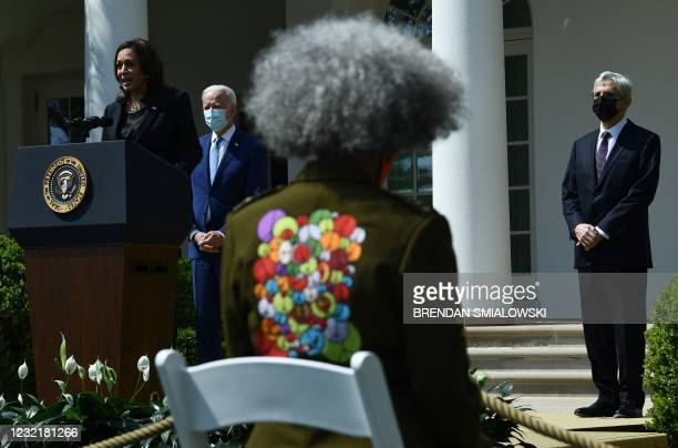 President Joe Biden , looks on as Vice President Kamala Harris speaks neat to Attorney General Merrick Garland during an event about gun violence...