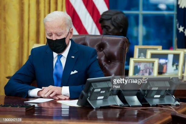 President Joe Biden makes brief remarks before signing several executive orders directing immigration actions for his administration in the Oval...