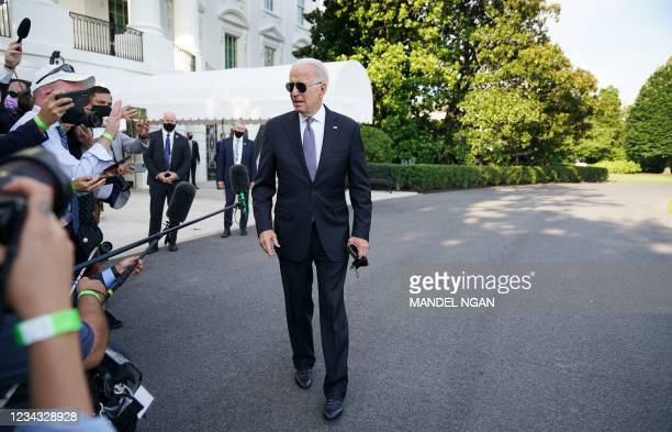 President Joe Biden makes his way to board Marine One on the South Lawn of the White House in Washington DC on July 30, 2021. - Biden is scheduled to...