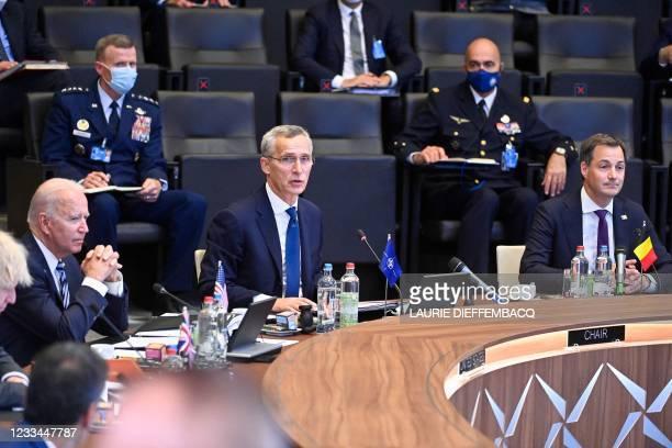 President Joe Biden, NATO Secretary General Jens Stoltenberg and Belgian Prime Minister Alexander De Croo attend a plenary session of a NATO summit...