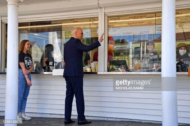 President Joe Biden orders an ice cream at Honey Hut Ice Cream in Cleveland, Ohio, on May 27, 2021.