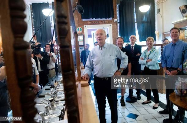 President Joe Biden orders an ice cream cone while visiting the The Pearl Ice Cream Parlor & Confectionery in La Crosse, Wisconsin, June 29, 2021. -...