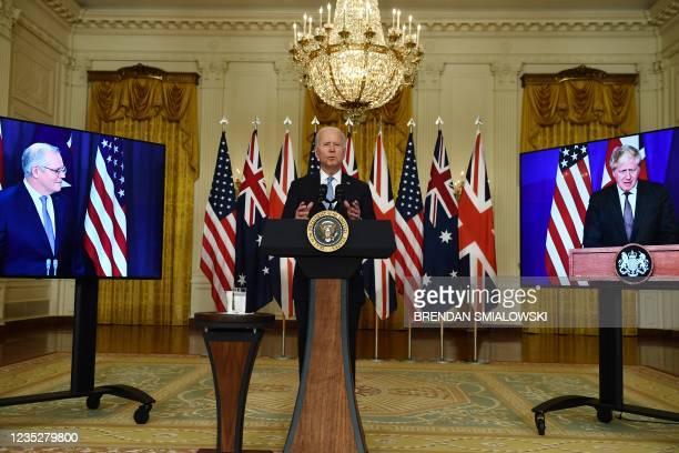 President Joe Biden participates is a virtual press conference on national security with British Prime Minister Boris Johnson and Australian Prime...