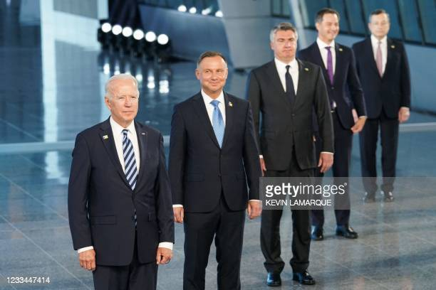 President Joe Biden, Poland's President Andrzej Duda and other NATO heads of the states and governments pose for a family photo during the NATO...