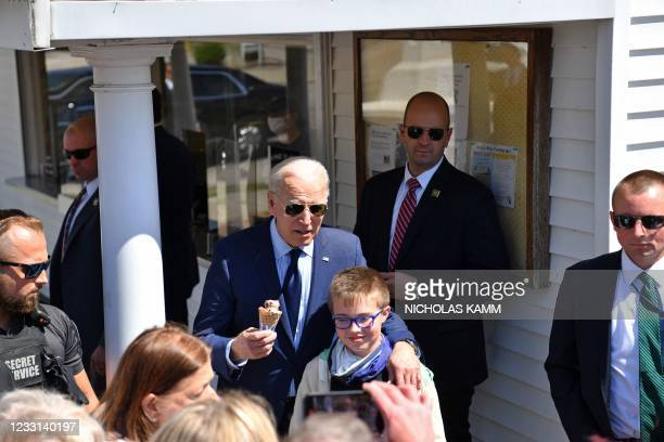 President Joe Biden poses for a photo with a kid after ordering an ice cream at Honey Hut Ice Cream in Cleveland, Ohio, on May 27, 2021.