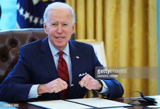 President Joe Biden prepares to sign executive orders on affordable healthcare in the Oval Office of the White House in Washington, DC, on January...