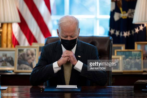 President Joe Biden prepares to sign the Paycheck Protection Program Extension Act of 2021 into law at the White House in Washington, DC, on March...