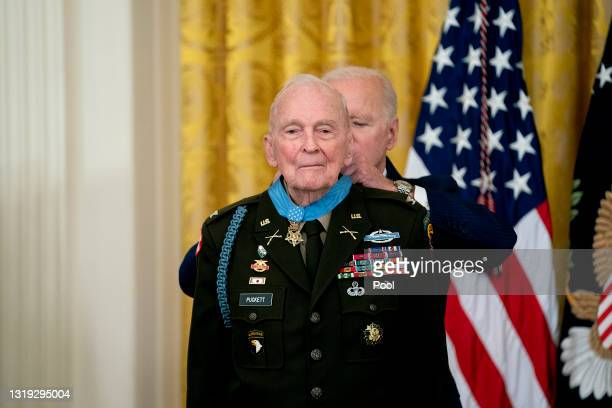President Joe Biden presents the Medal of Honor to Army Colonel Ralph Puckett in the East Room of the White House May 21, 2021 in Washington, DC.....