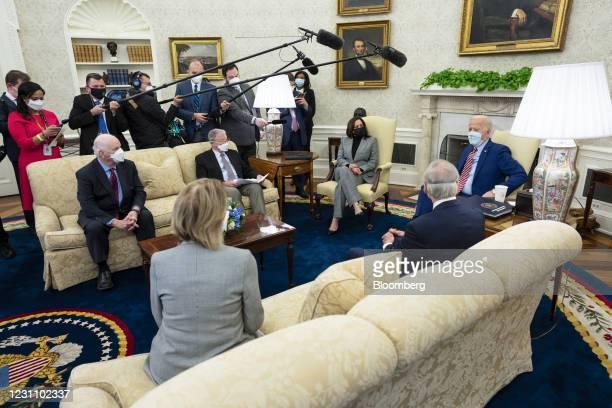 President Joe Biden, right, and U.S. Vice President Kamala Harris, center, wear protective masks while meeting with Senator Shelley Moore Capito, a...