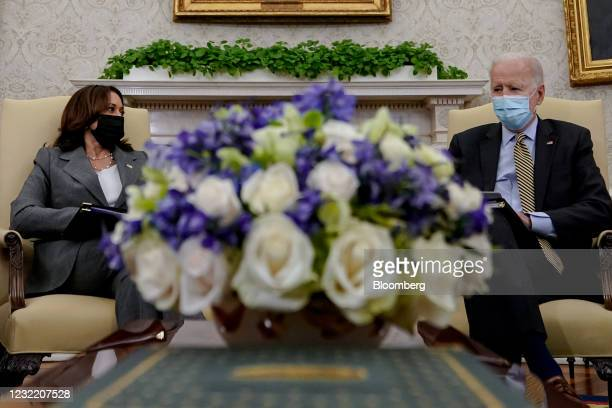 President Joe Biden, right, and U.S. Vice President Kamala Harris receive the weekly economic briefing in the Oval Office of the White House in...